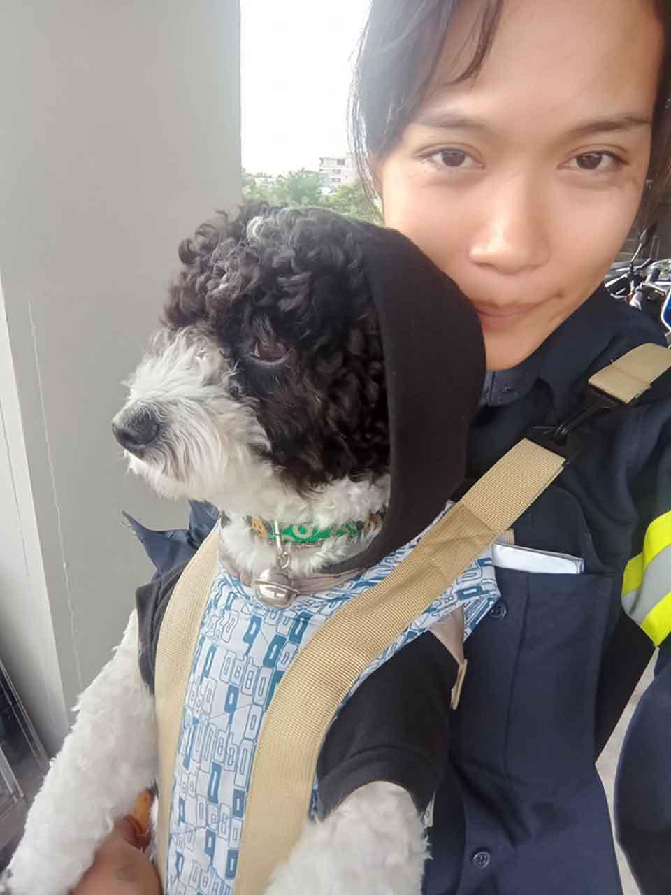 Thitirat Keowa-ram street sweeper in Bangkok woman working dog